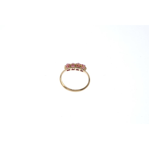 453 - A spinel four-stone ring. The red spinel crystal line, with knife-edge band. Ring size J. Weight 2.4...