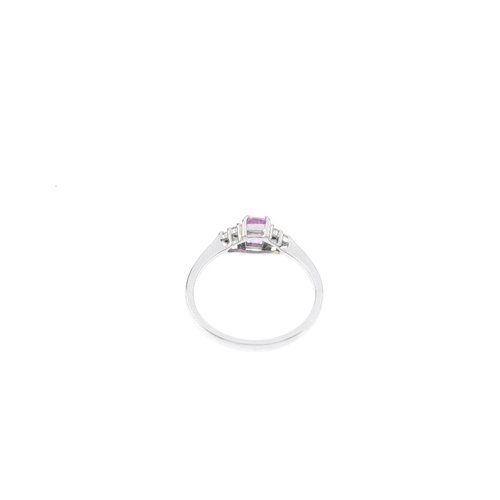 454 - An 18ct gold sapphire and diamond ring. The rectangular-shape pink sapphire, with single-cut diamond...