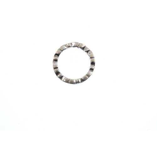 460 - A diamond full-circle eternity ring. Designed as a series of brilliant-cut diamonds, each with alter...