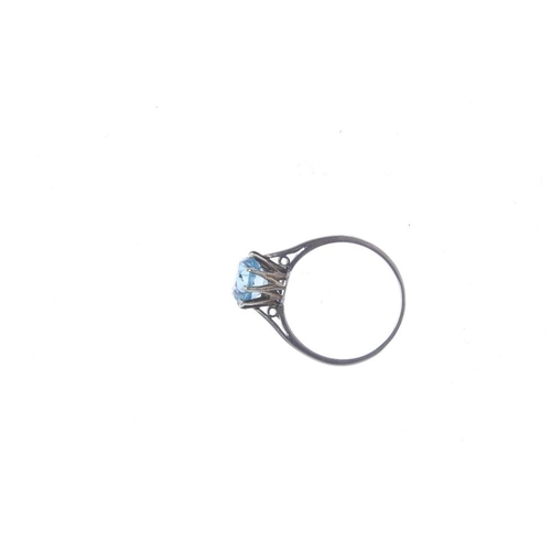 461 - A zircon single-stone ring. The circular-shape blue zircon, with tapered shoulders. Ring size K1/2. ...
