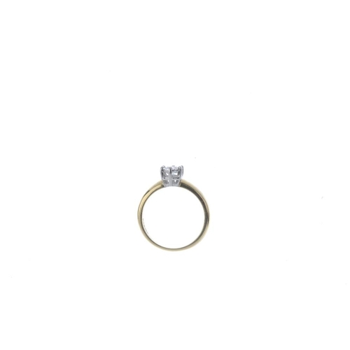 464 - An 18ct gold diamond single-stone ring. Of bi-colour design, the brilliant-cut diamond, within an il...
