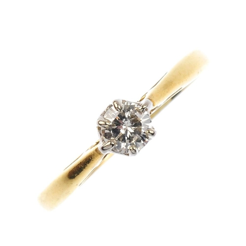 467 - An 18ct gold diamond single-stone ring. The brilliant-cut diamond, with tapered shoulders. Estimated...