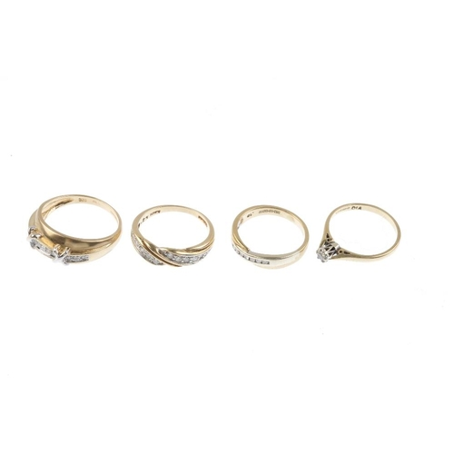 468 - Four 9ct gold diamond dress rings. To include a diamond band ring with scrolling grooved bar spacer,...