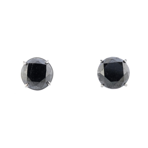 469 - A pair of colour treated 'black' brilliant-cut diamond ear studs. Total diamond weight 4cts. Weight ...