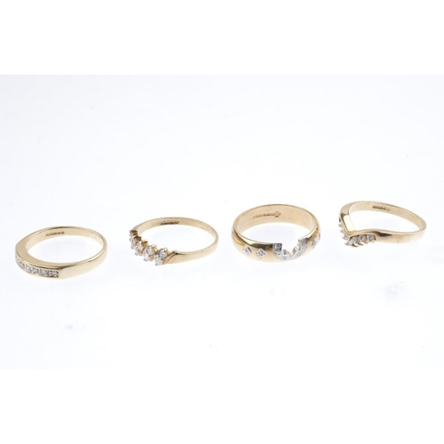 474 - Four 9ct gold diamond rings. To include a chevron ring, a half-circle eternity ring, a two-row ring,...