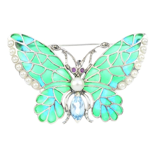 475 - A gem-set, imitation pearl and plique-a-jour enamel butterfly brooch. The marquise-shape blue topaz ...
