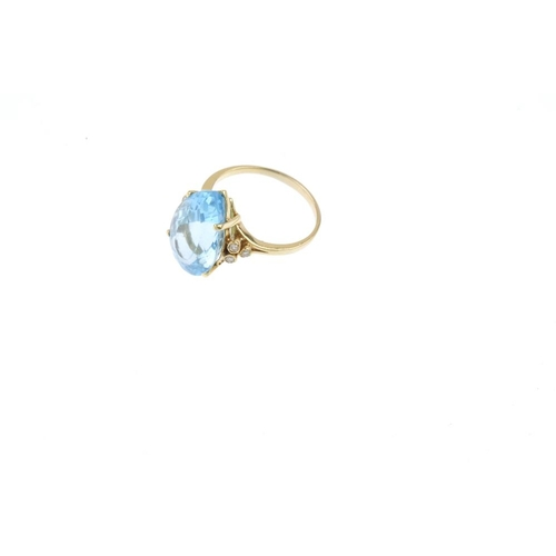 48 - A topaz and diamond ring. The pear-shape blue topaz, with single-cut diamond collet trefoil sides. E...