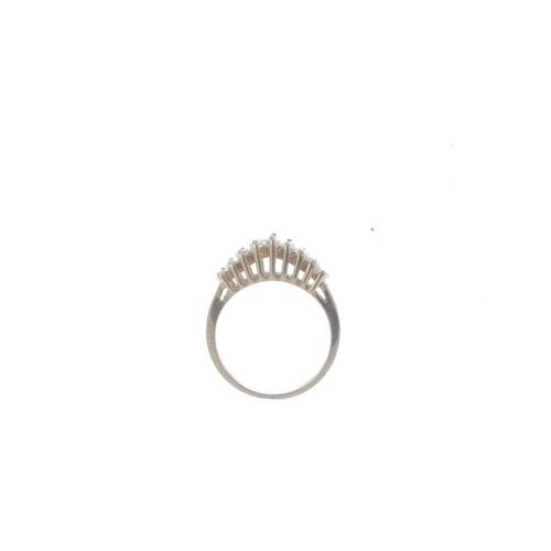 483 - A 14ct gold diamond nine-stone ring. The graduated marquise-shape stepped line, with openwork should...
