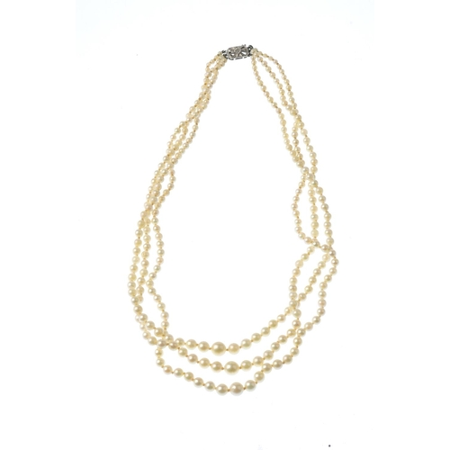 486 - A cultured pearl three-row necklace, with eleven loose mabe pearls. The necklace comprising three gr...