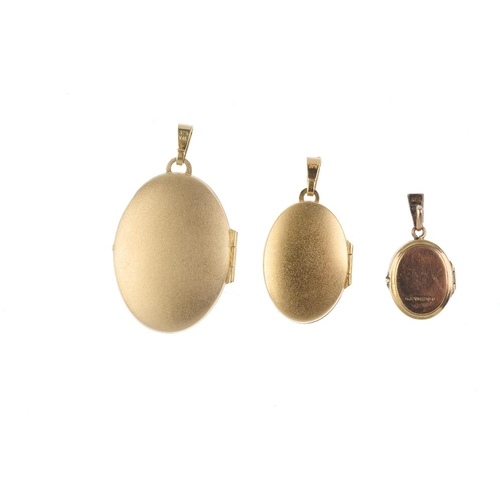 489 - Three lockets. To include a 9ct gold oval-shape locket, with engine turned detail, an oval-shape tex...