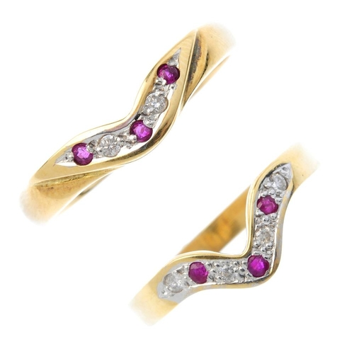 49 - Two 18ct gold ruby and diamond rings. Each designed as an alternating circular-shape ruby and brilli...