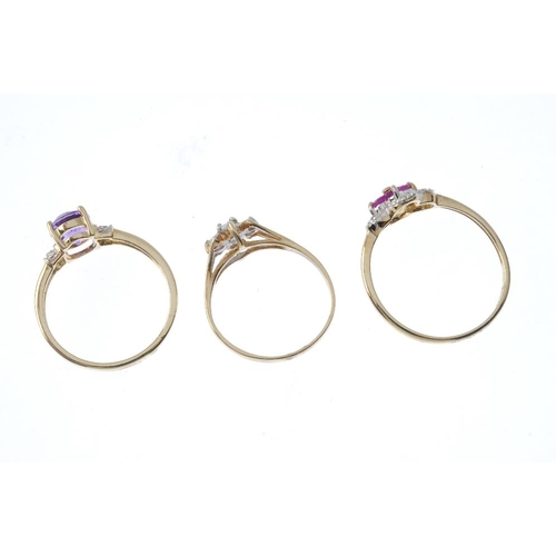 490 - Three 9ct gold diamond and gem-set rings. To include a ruby and diamond floral cluster ring, an amet...
