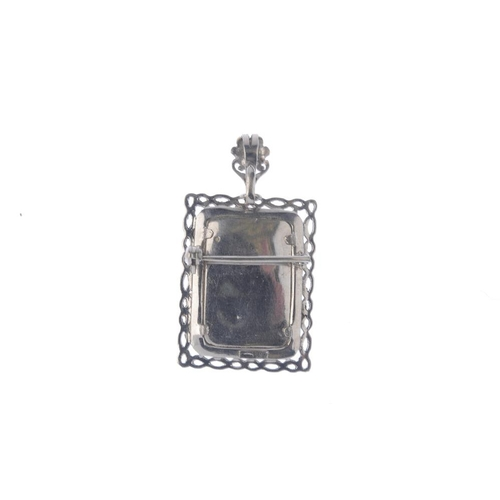 495 - A portrait pendant. Of rectangular-shape outline. depicting a lady in a period dress with single-cut...