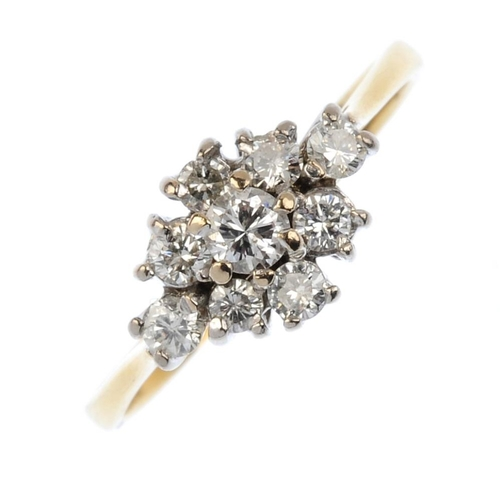 496 - An 18ct gold diamond cluster ring. The brilliant-cut diamond, within a similarly-cut diamond marquis...