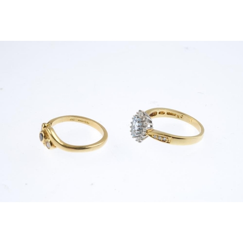 497 - Two 18ct gold diamond and gem-set rings. To include an aquamarine and diamond cluster ring, together...