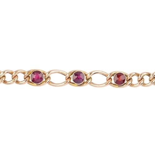 499 - An Edwardian 9ct gold garnet bracelet. The circular-shape garnet collet highlight curb-chain, with h...
