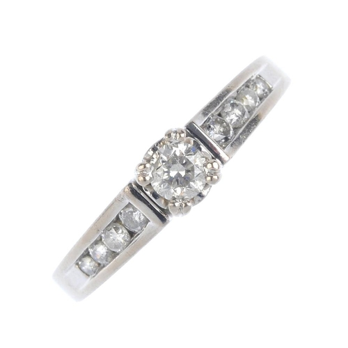 500 - An 18ct gold diamond single-stone ring. The brilliant-cut diamond, with graduated similarly-cut diam...