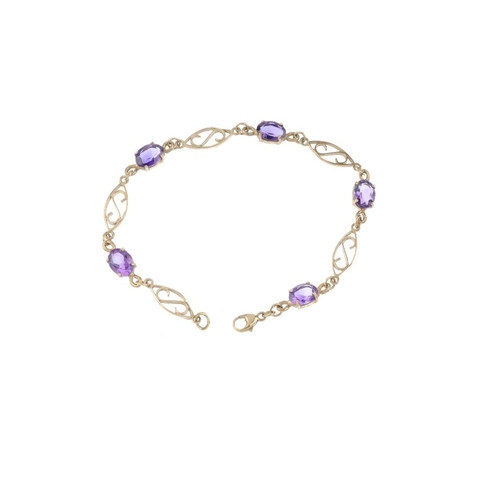 502 - A 9ct gold amethyst bracelet. Designed as a series of oval-shape amethysts, with openwork spacers an...