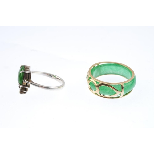 503 - Two jade rings. The first designed as a jadeite cabochon designed as an apple, with colourless-gem l...