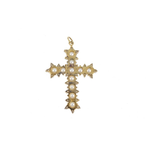 504 - A cultured pearl and diamond cross pendant. Designed as a series of cultured pearls, within a single...
