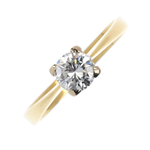 507 - An 18ct gold diamond single-stone ring. The brilliant-cut diamond, with tapered shoulders and plain ...