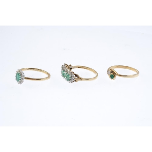 509 - Three 9ct gold diamond and emerald rings. To include a two-stone crossover ring, a cluster ring, tog...