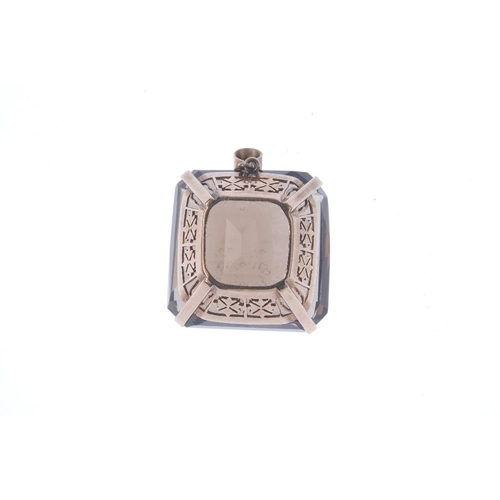 510 - A smoky quartz pendant. The cushion-shape smoky quartz, with openwork gallery and tapered surmount. ...