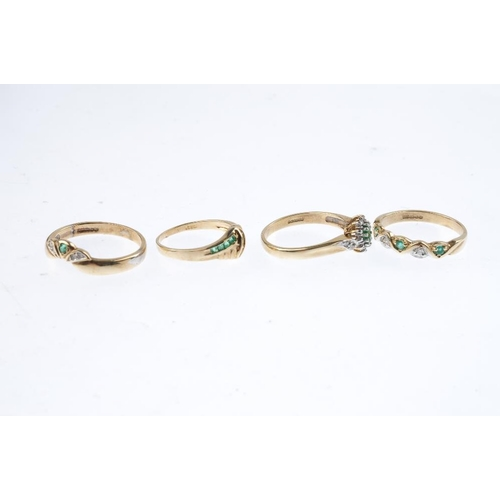 512 - Four 9ct gold diamond and emerald rings. To include a cluster ring, an alternating band ring, a chev...