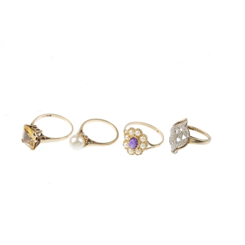513 - Four 9ct gold gem-set rings. To include an oval amethyst cabochon and split pearl cluster ring, a si...
