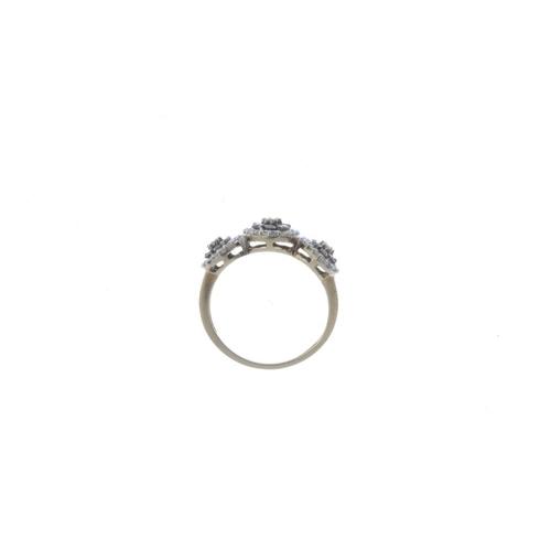 516 - A 9ct gold diamond triple cluster ring. Designed as a graduated brilliant-cut diamond cluster line, ...