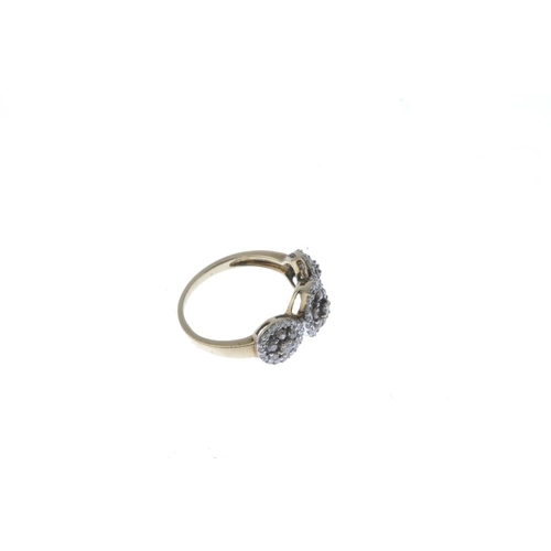 516 - A 9ct gold diamond triple cluster ring. Designed as a graduated brilliant-cut diamond cluster line, ...