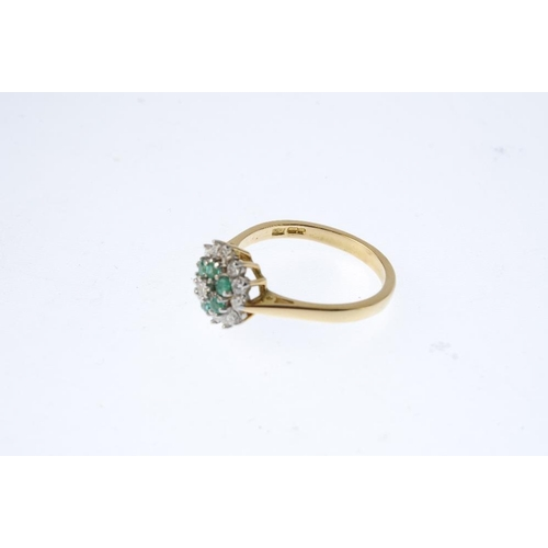 518 - An 18ct gold emerald and diamond cluster ring. The brilliant-cut diamond, with circular-shape emeral...