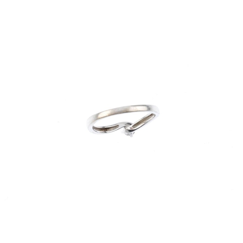 519 - An 18ct gold diamond single-stone ring. The brilliant-cut diamond, to the asymmetric shoulders and p...
