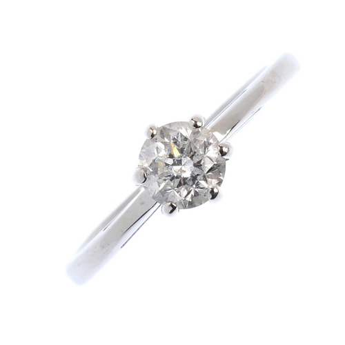 520 - An 18ct gold diamond single-stone ring. The brilliant-cut diamond, with tapered shoulders and plain ...