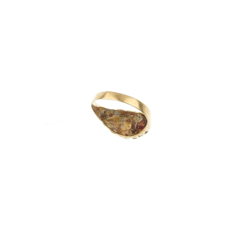 521 - An Edwardian 18ct gold opal and diamond ring. The oval opal cabochons, with diamond accent highlight...