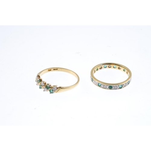 522 - Two 18ct gold emerald and diamond rings. To include a circular-shape emerald and brilliant-cut diamo...