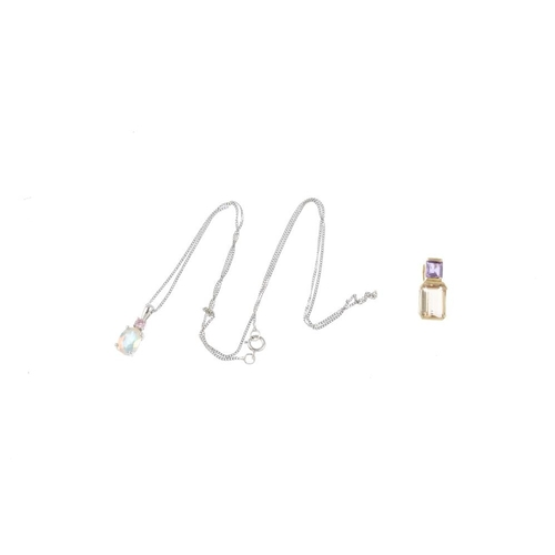 523 - Three pendants. To include a citrine and amethyst pendant, a coated cubic zirconia and pink cubic zi...