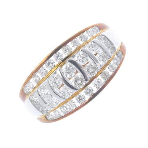 525 - A 14ct gold diamond ring. Of bi-colour design, comprising two graduated brilliant-cut diamond lines,...