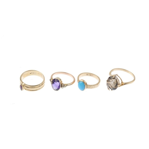 538 - Four gem-set rings. To include a 9ct gold amethyst single-stone and grooved band ring, a smoky quart...