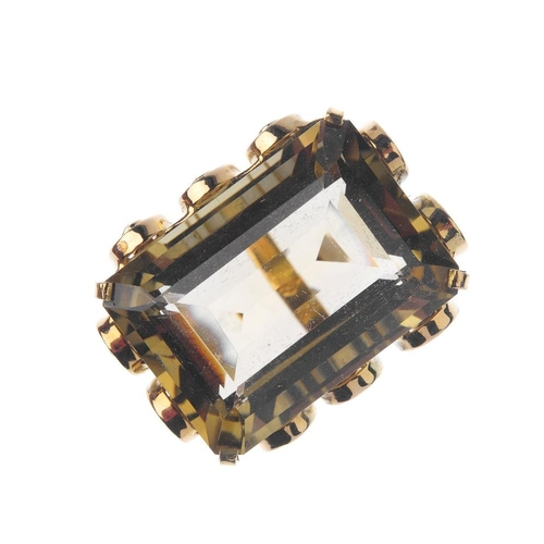 539 - A citrine and diamond dress ring. The rectangular-shape citrine, with brilliant-cut diamond collet s...