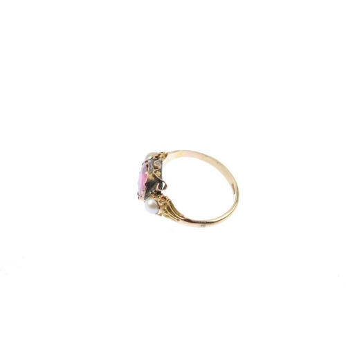 541 - A synthetic ruby and cultured pearl ring. The circular-shape synthetic ruby, with cultured pearl sid...