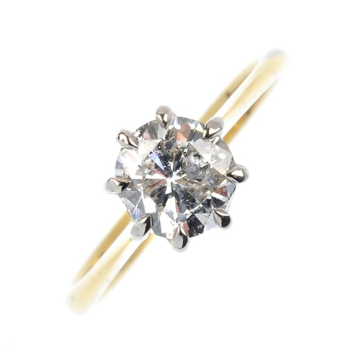 543 - An 18ct gold diamond single-stone ring. The brilliant-cut diamond, with tapered shoulders. Estimated...