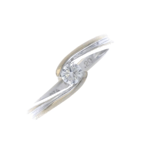 546 - An 18ct gold diamond single-stone ring. The brilliant-cut diamond, with grooved asymmetric shoulders...