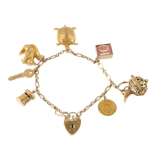 549 - A 9ct gold charm bracelet. The fancy-link bracelet, suspending seven charms, to include a tortoise, ...
