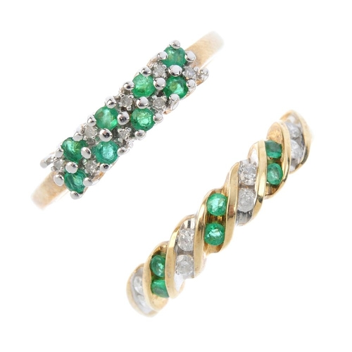 550 - Four 9ct gold emerald and diamond rings. To include an emerald and diamond chevron-shape ring, an em...