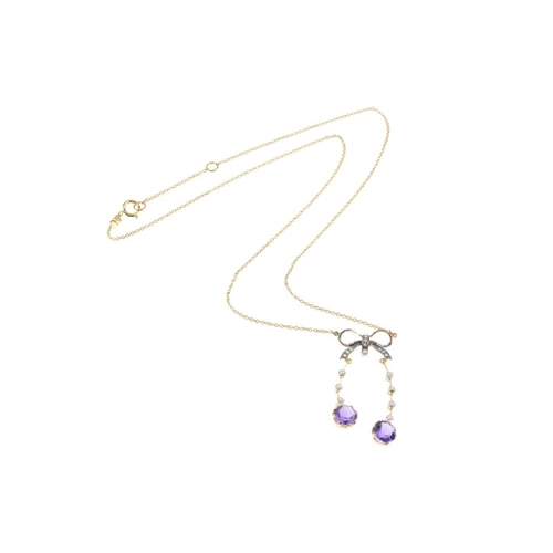 552 - A amethyst and split pearl negligee pendant. Comprising two circular-shape amethysts, each suspended...