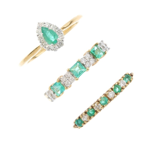 553 - Three 9ct gold emerald and diamond rings. To include an emerald and diamond cluster ring, an emerald...