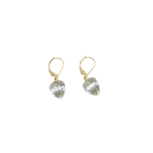 554 - A pair of green-stone earrings. Each designed as a fancy-cut prasiolite drop, with foliate cap. Leng...