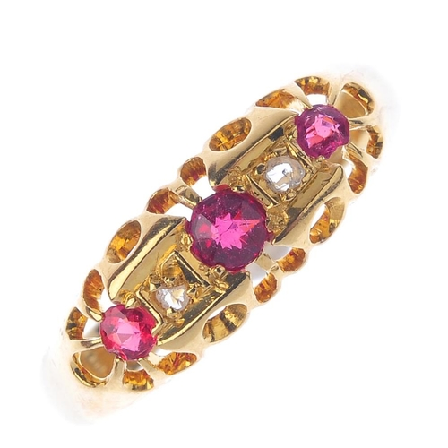 556 - A 1920s 18ct gold ruby and diamond dress ring. The circular-shape ruby and rose-cut diamond alternat...