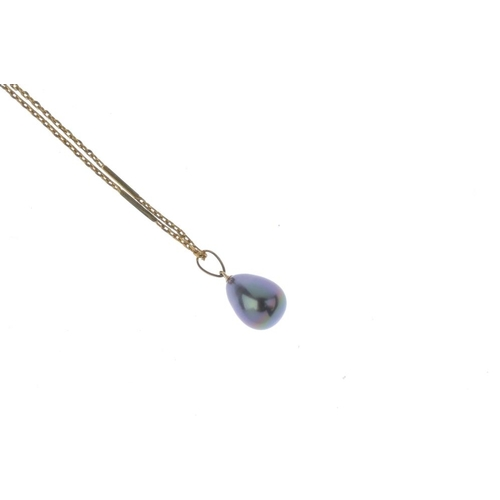 558 - A cultured pearl pendant. The cultured pearl drop, suspended from a tapered surmount loop and trace-...